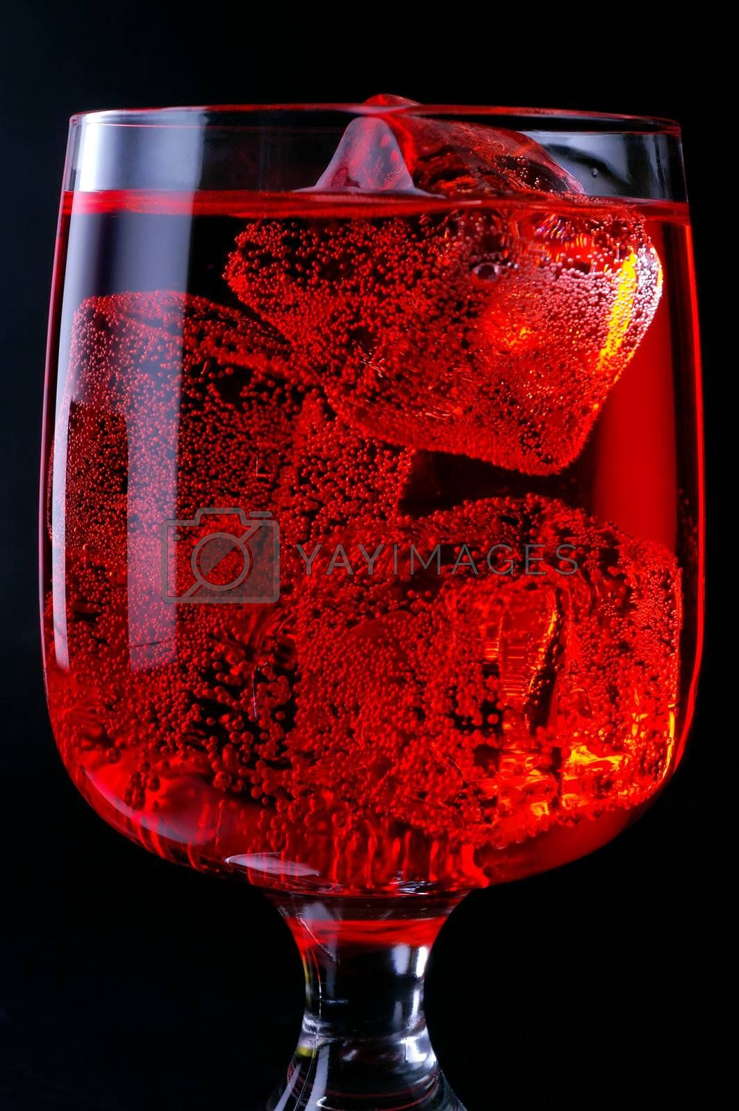 Glass of red drink with ice closeup (C4)