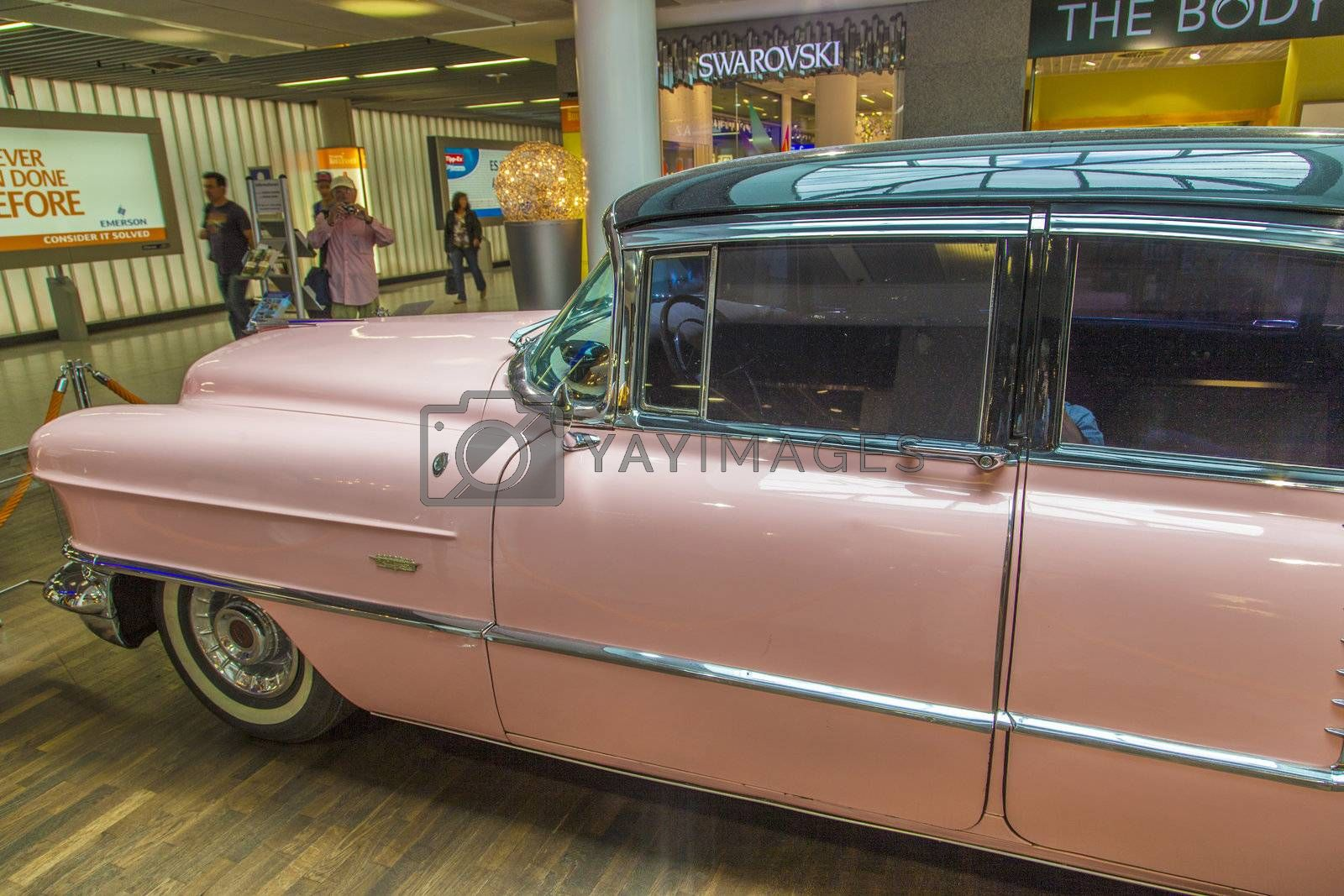 FRANKFURT, GERMANY - JUNE 8:  pink 1956 Cadillac at the airport on June 8, 2012 in Frankfurt, Germany. It belongs to the museum of Sinsheim with more than 1 Millon visitors per year.