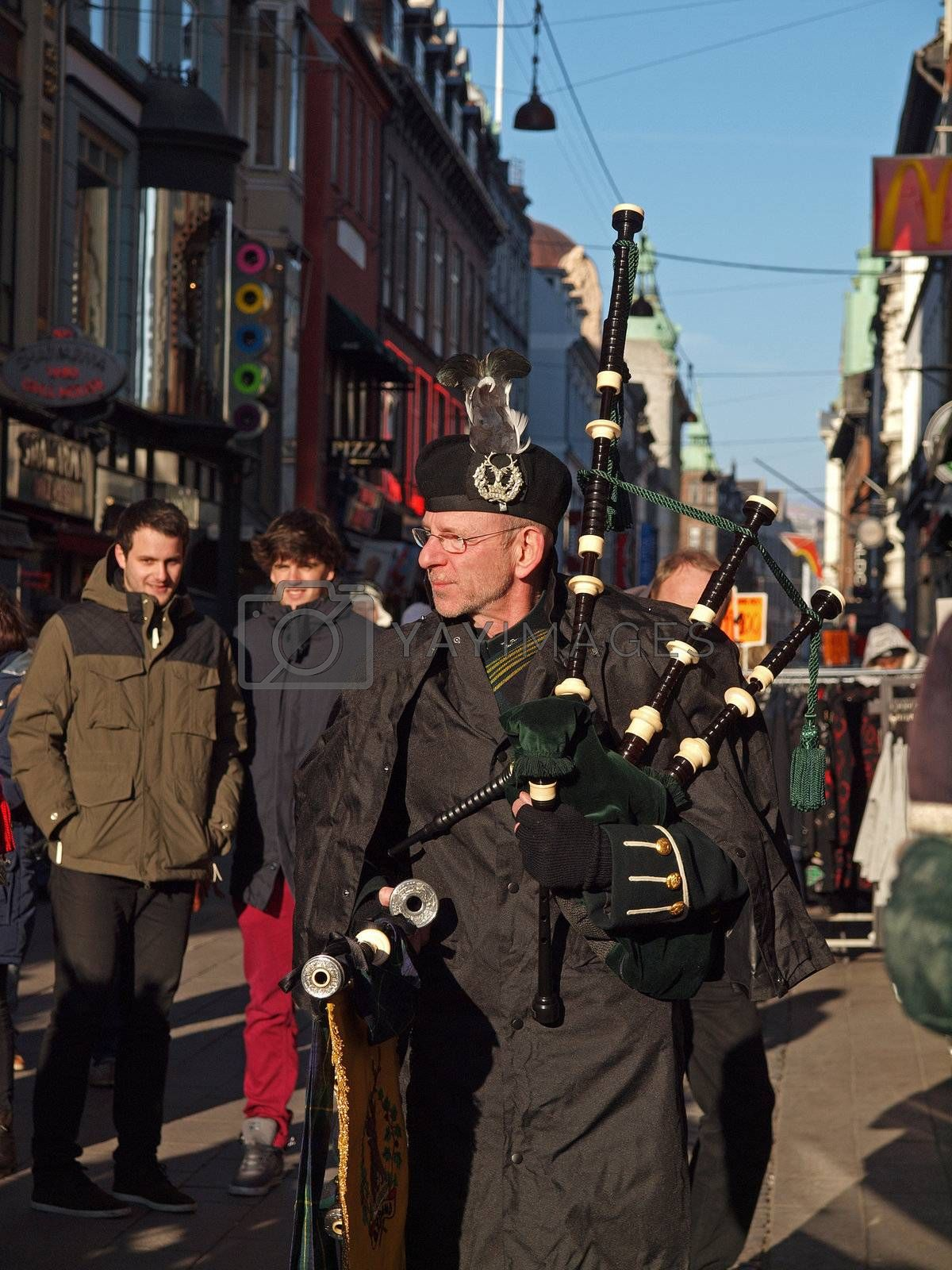 COPENHAGEN - MAR 17: Bagpiper at the annual St. Patrick's Day celebration and parade in front of Copenhagen City Hall, Denmark on March 17, 2013.