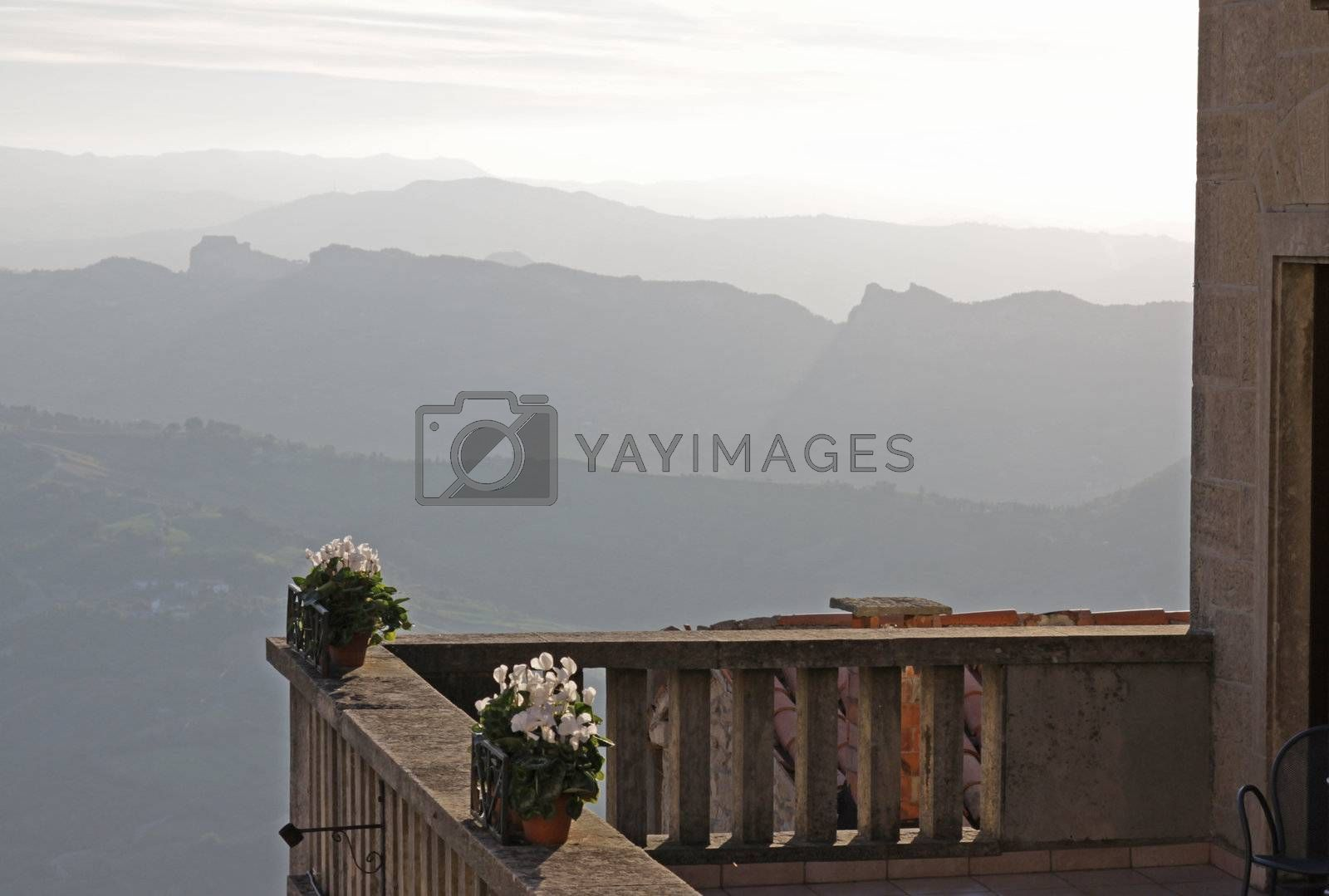 A hotel balcony looking out over the rolling hills of the Republic of San Marino.
