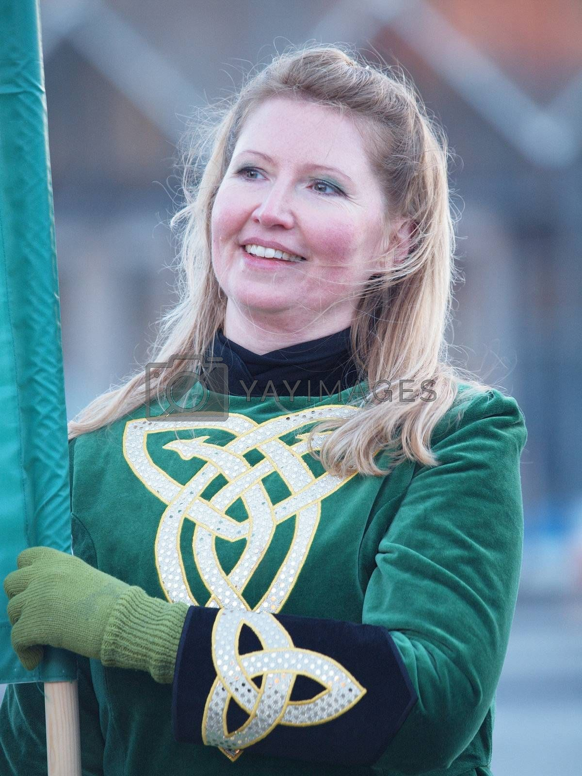 COPENHAGEN - MAR 17: Woman participant in green costume at the annual St. Patrick's Day celebration and parade in front of Copenhagen City Hall, Denmark on March 17, 2013.
