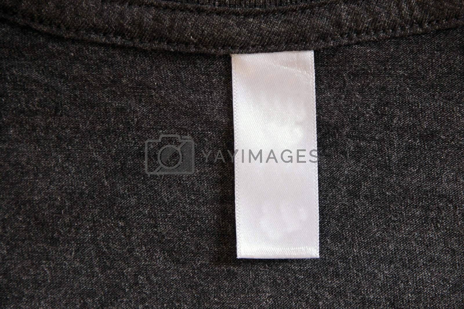 A dark gray shirt and a white label.