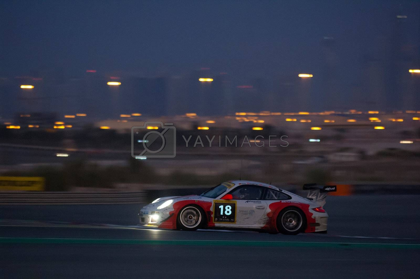 DUBAI - JANUARY 14: Car 18, a Porsche 997 GT3 R, early in the morning during the 2012 Dunlop 24 Hour Race at Dubai Autodrome on January 14, 2012.