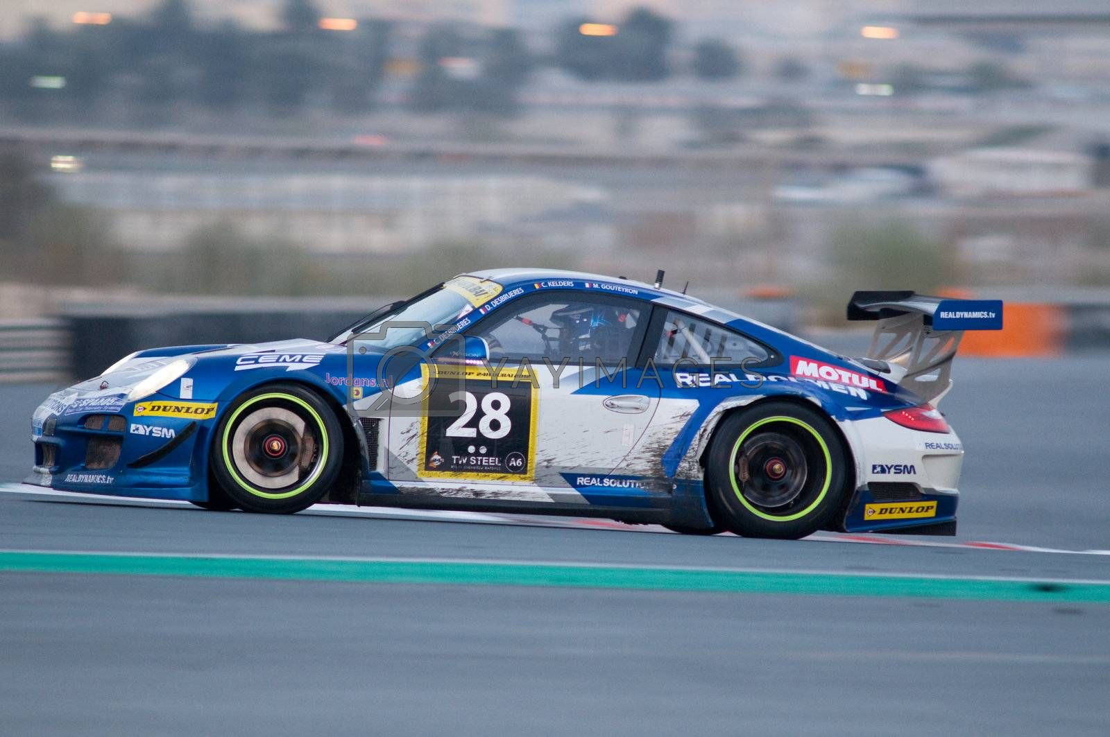 DUBAI - JANUARY 14: Car 28, a Porsche 997 GT3 R, in the morning during the 2012 Dunlop 24 Hour Race at Dubai Autodrome on January 14, 2012.