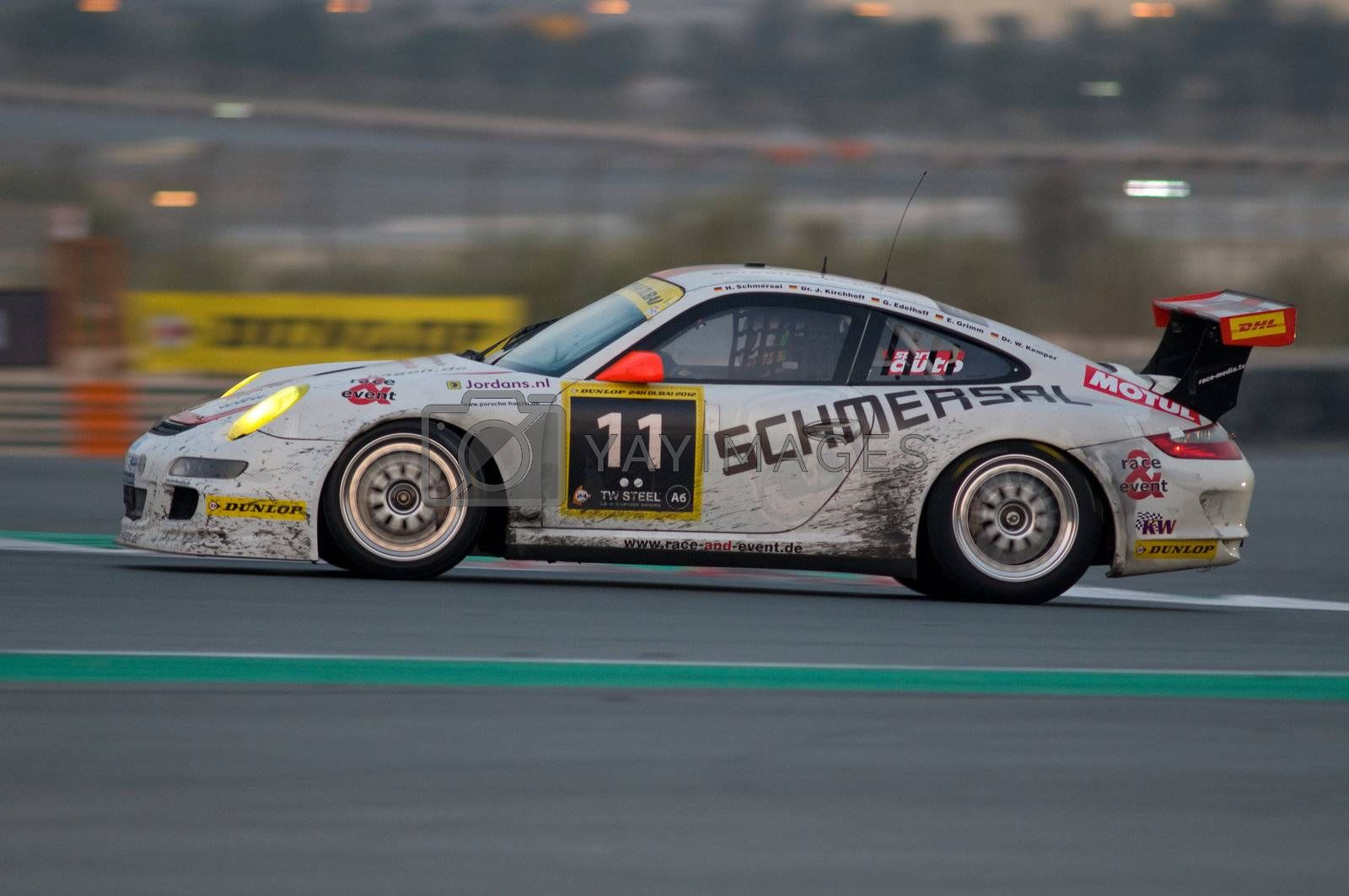 DUBAI - JANUARY 14: Car 11, a Porsche 997 GT3 Cup 5, in the morning hours during the 2012 Dunlop 24 Hour Race at Dubai Autodrome on January 14, 2012.