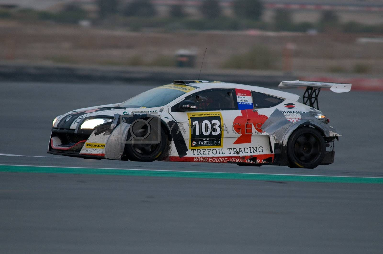 DUBAI - JANUARY 14: Car 103, a Renault Megane Trophy, during the morning hours of the 2012 Dunlop 24 Hour Race at Dubai Autodrome on January 14, 2012.
