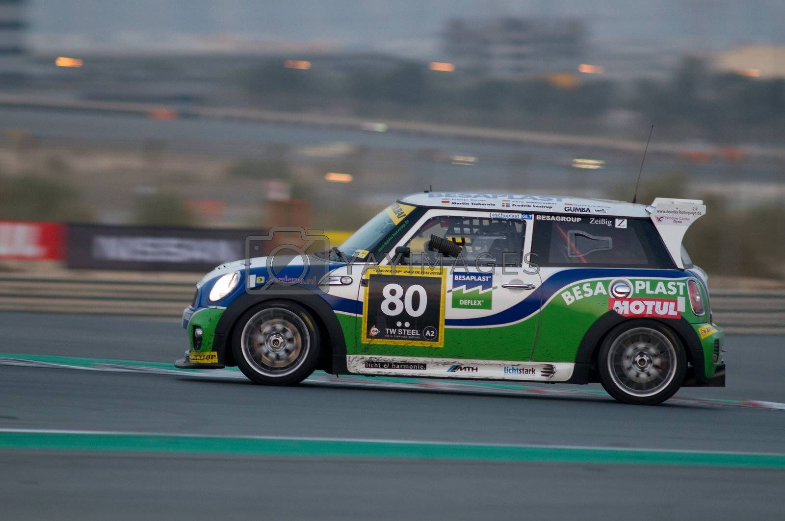 DUBAI - JANUARY 14: Car 180, a BMW Mini, during the morning hours of the 2012 Dunlop 24 Hour Race at Dubai Autodrome on January 14, 2012.