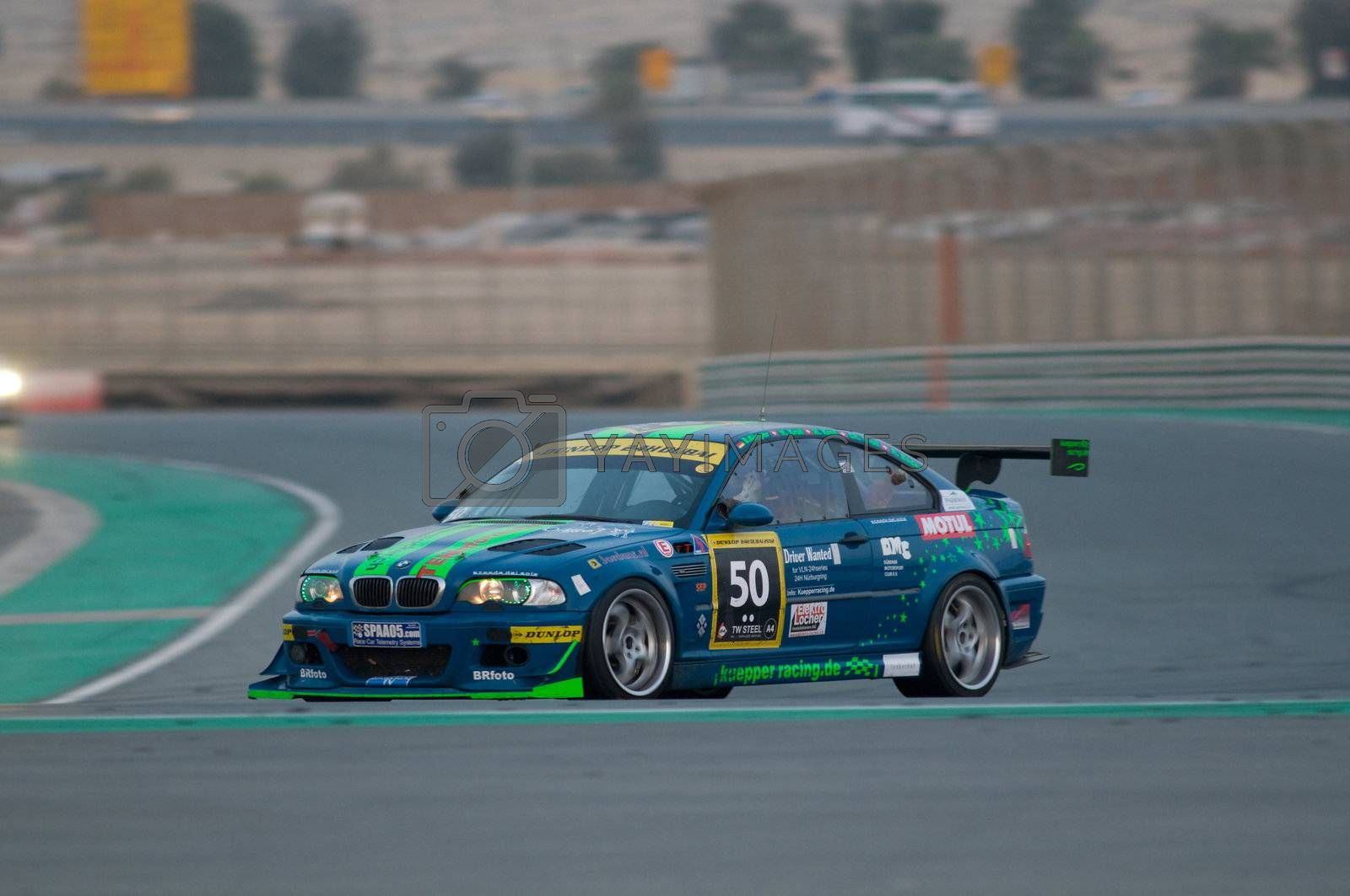 DUBAI - JANUARY 14: Car 50, a BMW E46 Coupe, during the morning hours of the 2012 Dunlop 24 Hour Race at Dubai Autodrome on January 14, 2012.