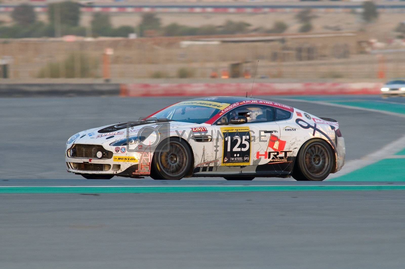 DUBAI - JANUARY 14: Car 119, an Aston Martin Vantage N24 GT4, during the morning hours of the 2012 Dunlop 24 Hour Race at Dubai Autodrome on January 14, 2012.