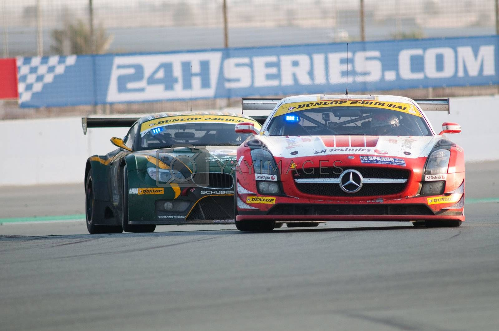 DUBAI - JANUARY 14: Race winner, a Mercedes SLS AMG GT3 in front of last year's winner, a BMW Z4 GT3, during the morning hours of the 2012 Dunlop 24 Hour Race at Dubai Autodrome on January 14, 2012.