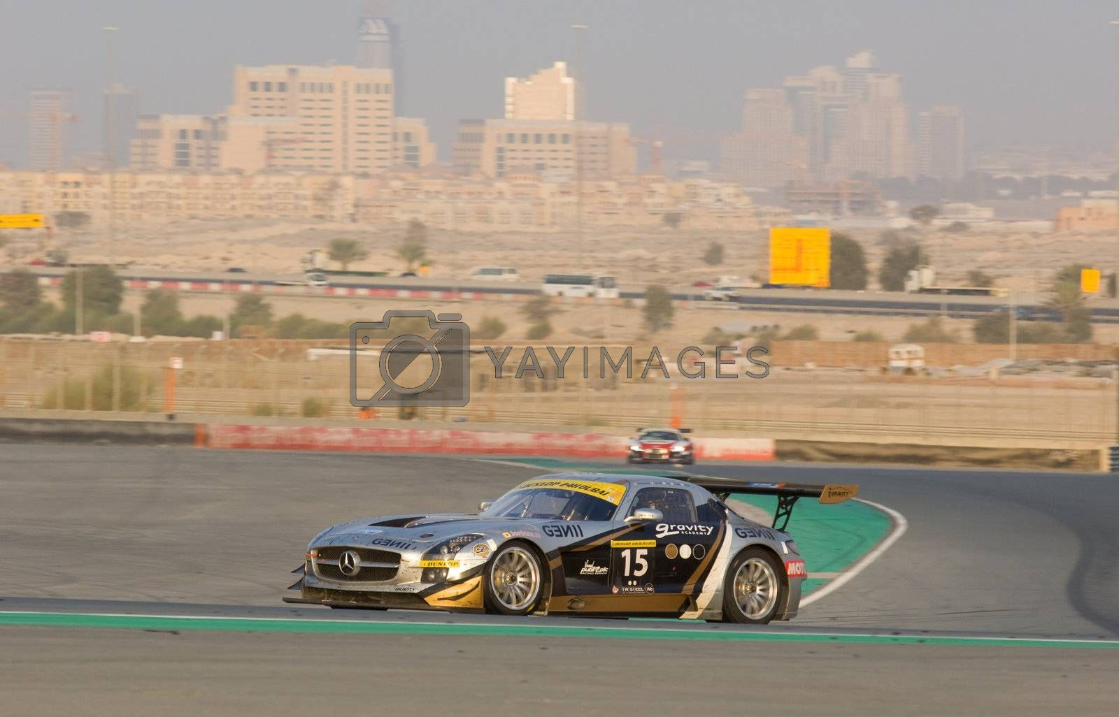DUBAI - JANUARY 14: Car 15, a Mercedes SLS AMG GT3 with Dubai City in the background, during the 2012 Dunlop 24 Hour Race at Dubai Autodrome on January 14, 2012.