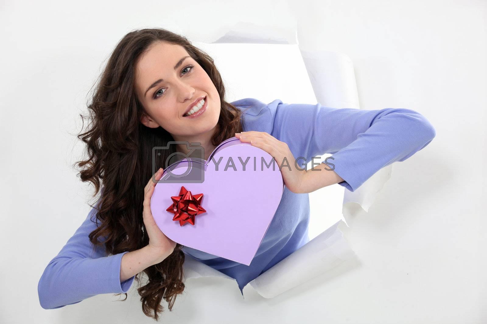 Woman holding a heart-shaped box