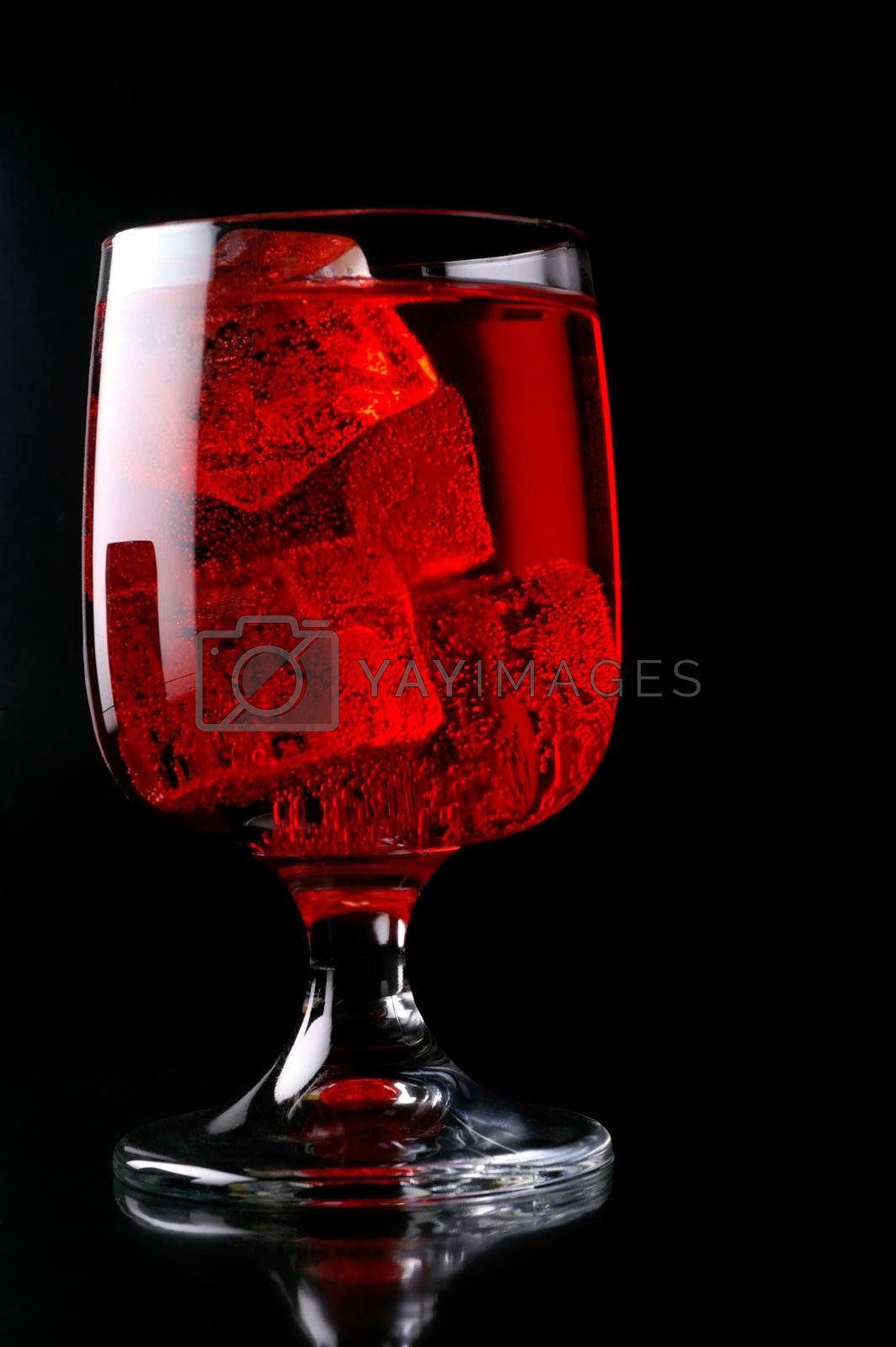 Glass of red drink with ice closeup (C2)