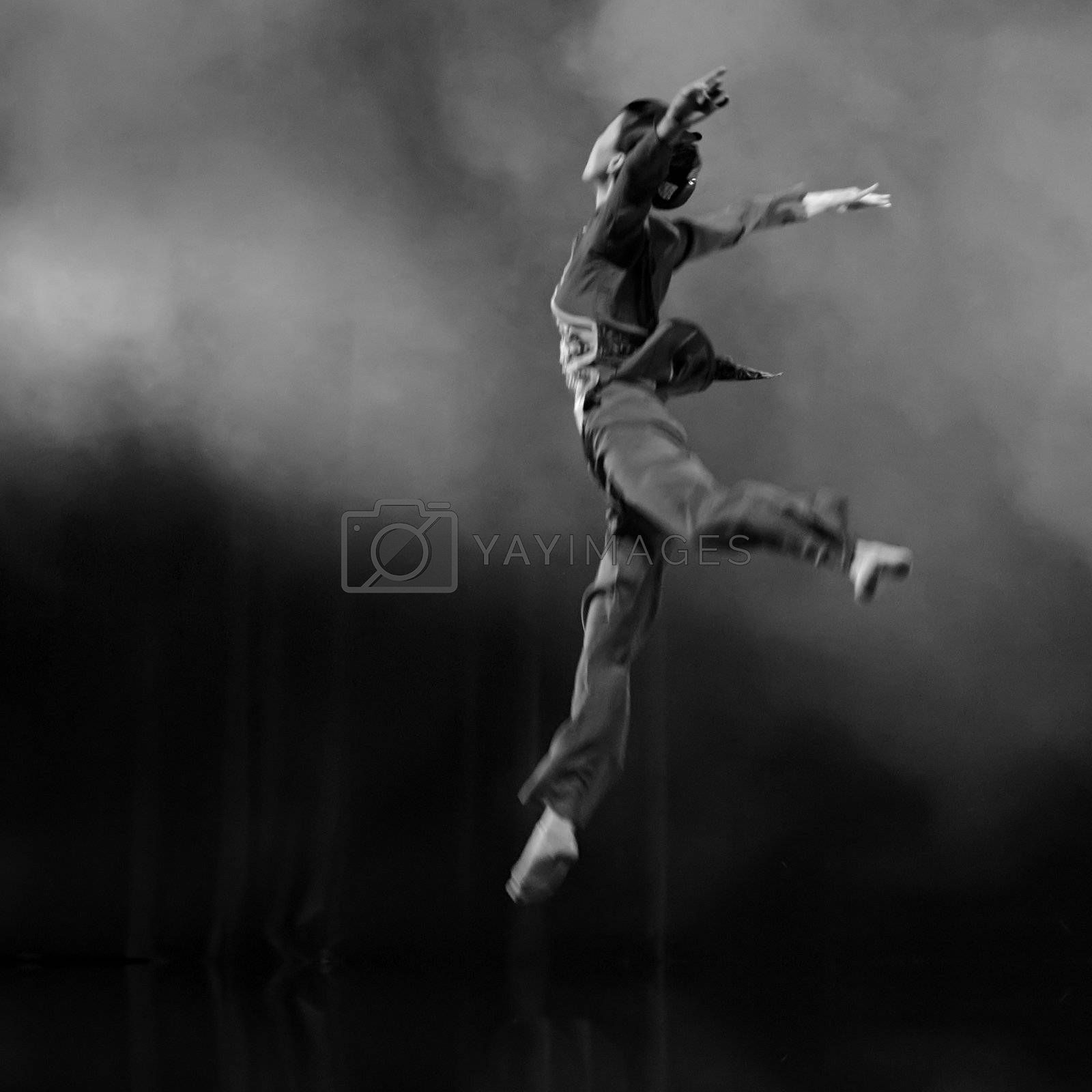 CHENGDU - DEC 16: Chinese dancer performs modern solo dance on stage at JINCHENG theater in the 7th national dance competition of china on Dec 16,2007 in Chengdu, China.