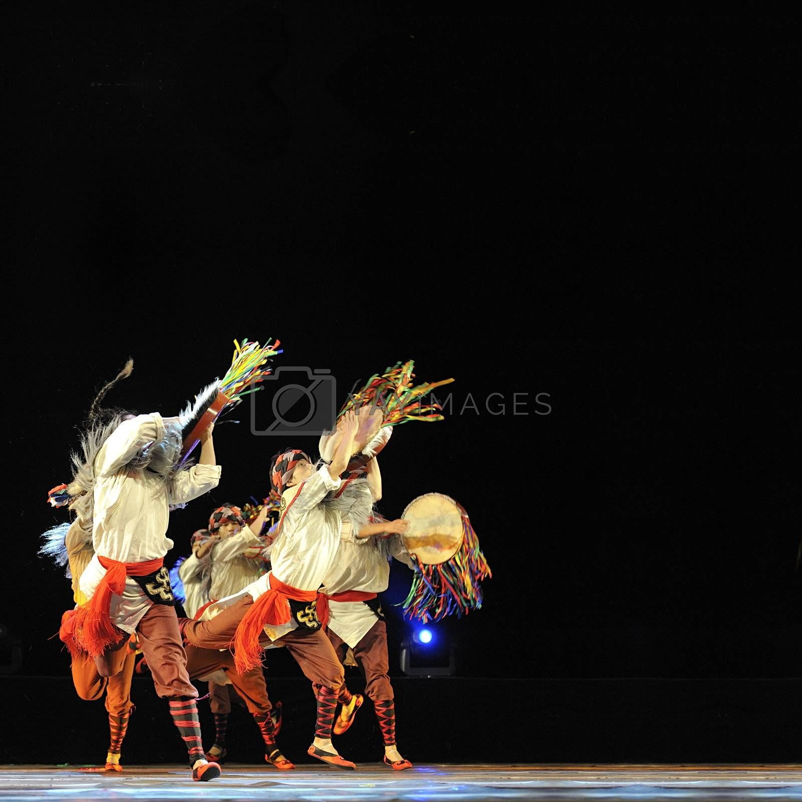 CHENGDU - SEP 28: chinese Qiang ethnic dancers perform on stage at Sichuan experimental theater.Sep 28,2010 in Chengdu, China.