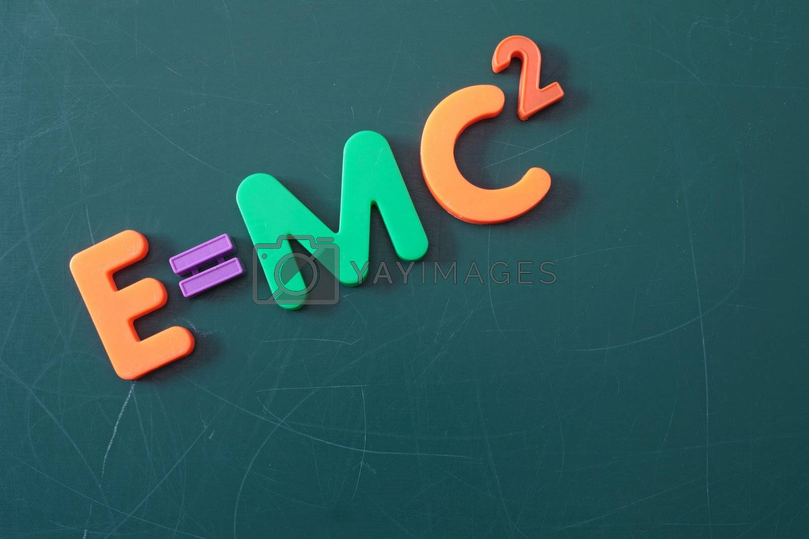 The famous theory of relativity shown on a chalkboard symbolizes education.