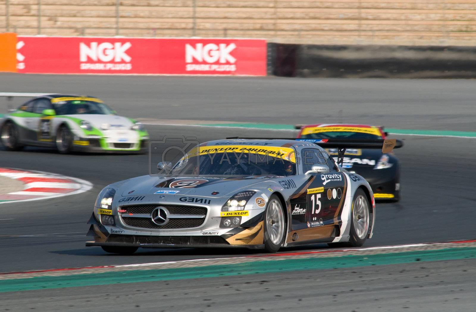 DUBAI - JANUARY 13: Car 15, a Mercedes SLS AMG GT3, participating in the 2012 Dunlop 24 Hour Race at Dubai Autodrome on January 13, 2012.