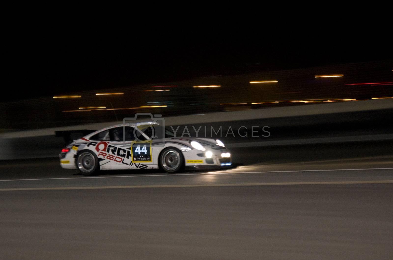 DUBAI - JANUARY 13: Car 44, a Porsche 997 GT3 Cup at night during the 2012 Dunlop 24 Hour Race at Dubai Autodrome on January 13, 2012.