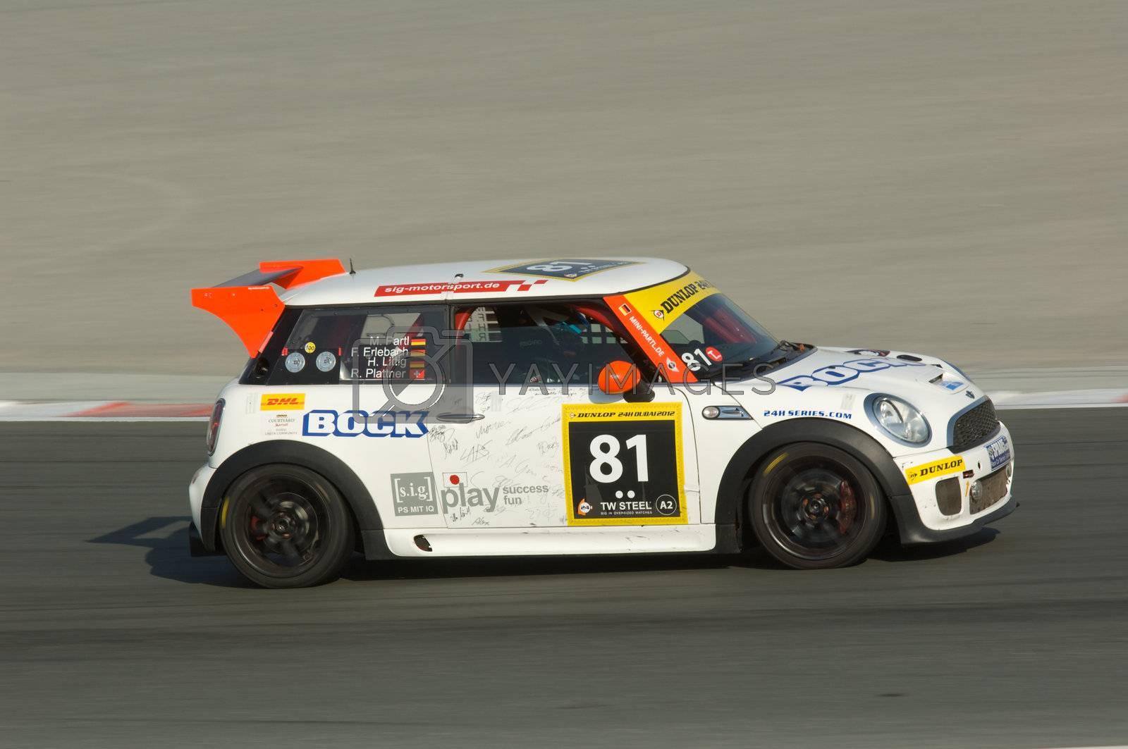 DUBAI - JANUARY 13: Car 81, a BMW Mini Cooper S, participating in the 2012 Dunlop 24 Hour Race at Dubai Autodrome on January 13, 2012.