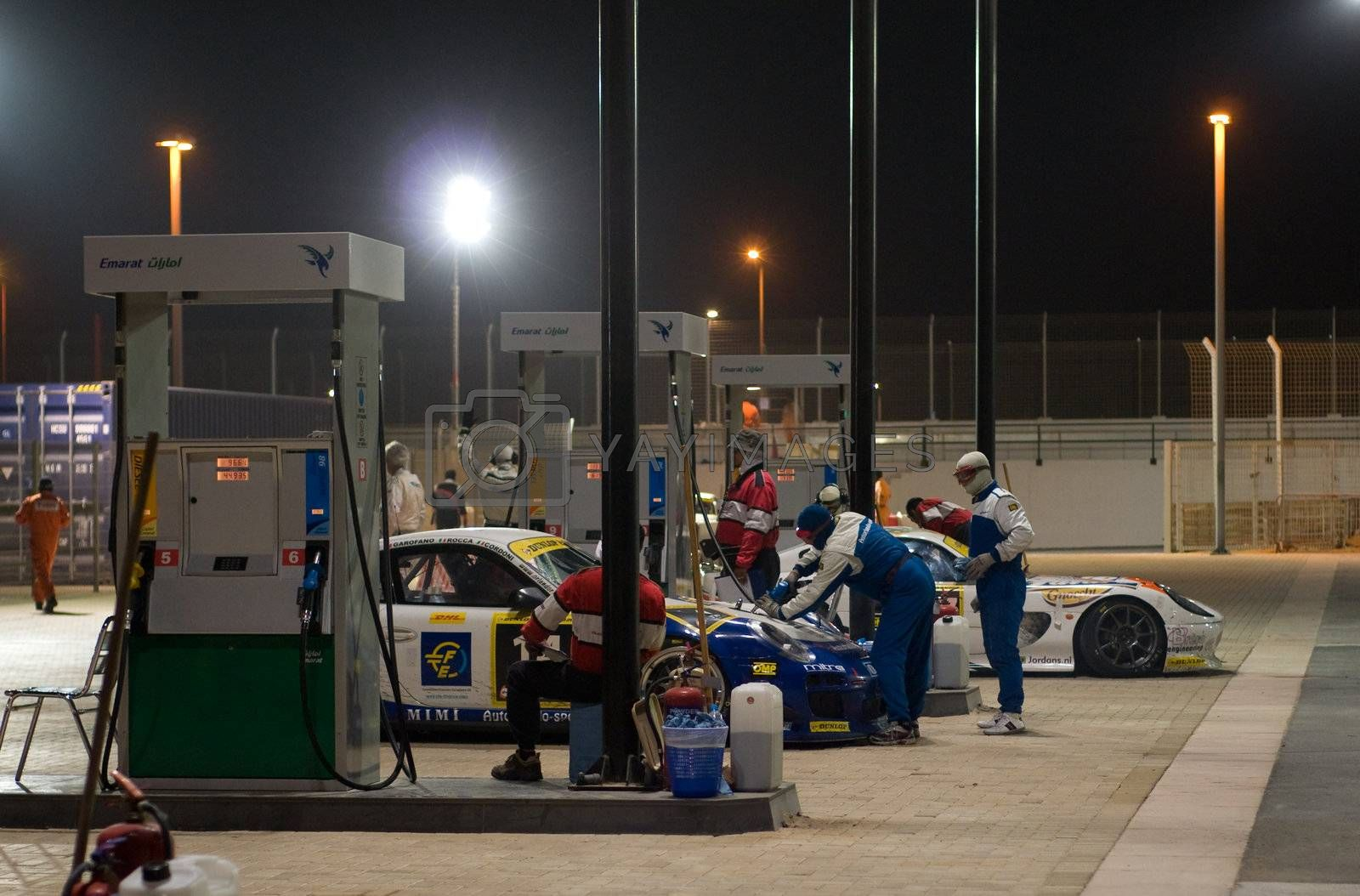 DUBAI - JANUARY 13: Re-fueling station for race cars in use during the 2012 Dunlop 24 Hour Race at Dubai Autodrome on January 13, 2012.
