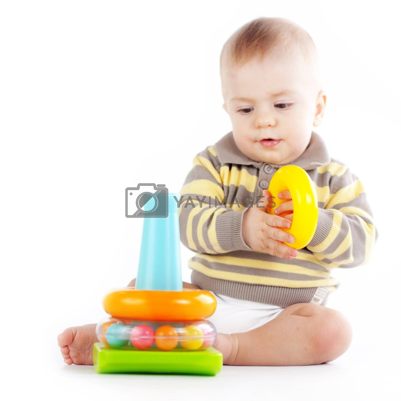 Baby playing with toys isolated on white