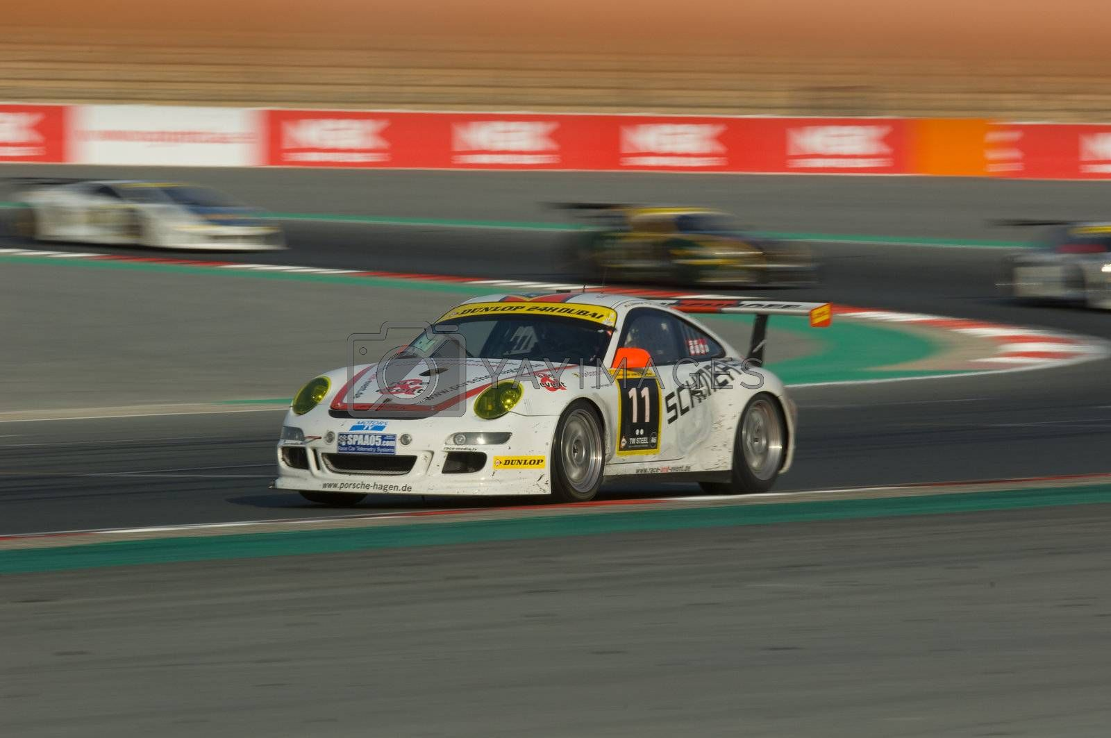 DUBAI - JANUARY 13: Car 11, a Porsche 997 GT3 Cup S, participating in the 2012 Dunlop 24 Hour Race at Dubai Autodrome on January 13, 2012.