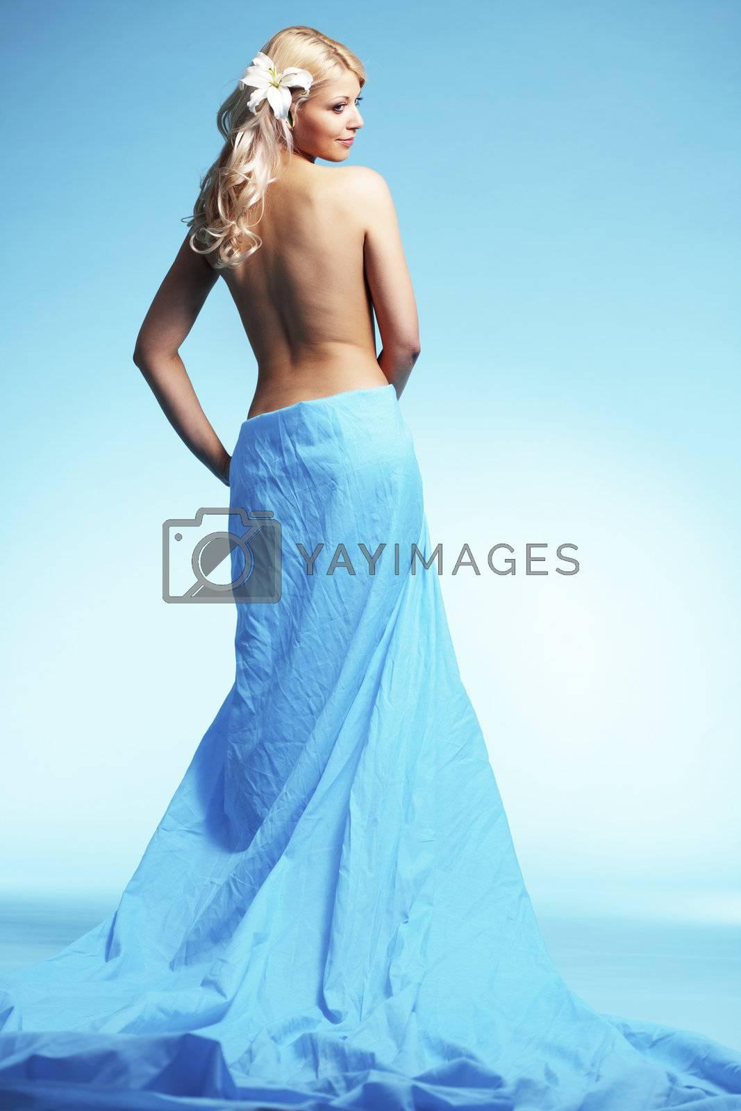 Portrait of very beautiful woman wearing long dress over blue
