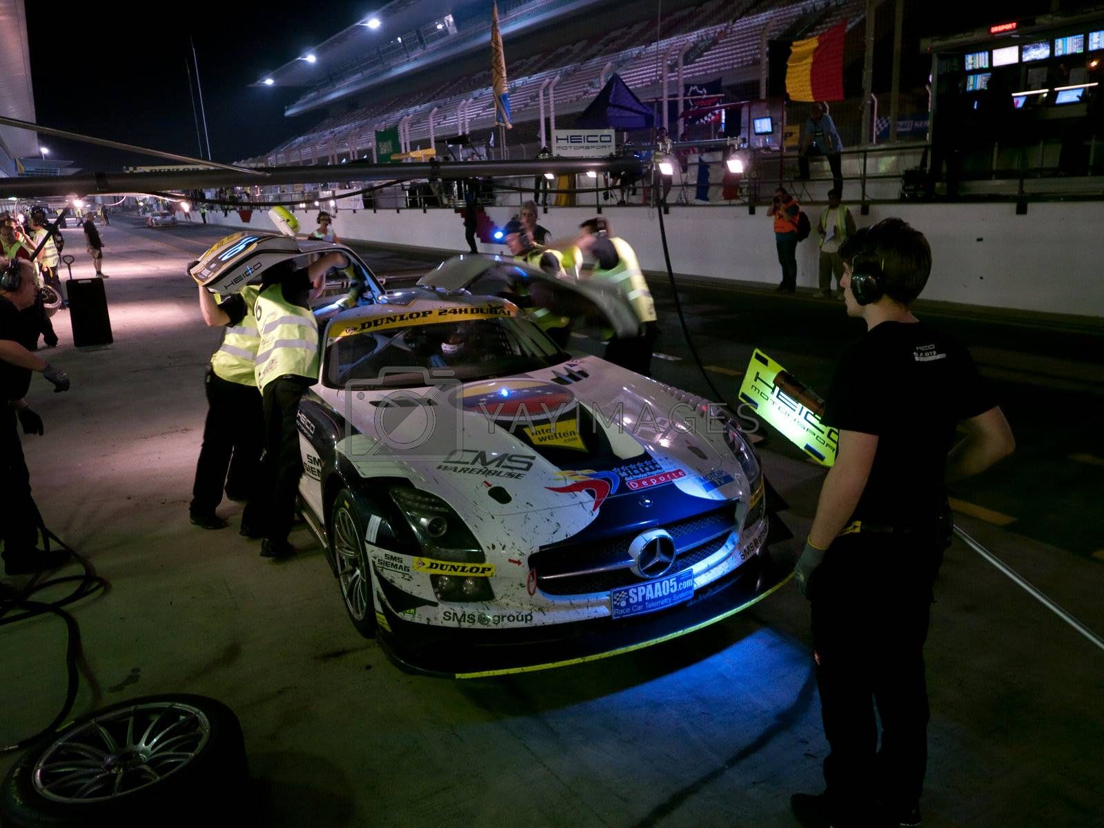 DUBAI - JANUARY 13: Car 16, a Mercedes SLS AMG GT3 during pit stop at night at the 2012 Dunlop 24 Hour Race at Dubai Autodrome on January 13, 2012.