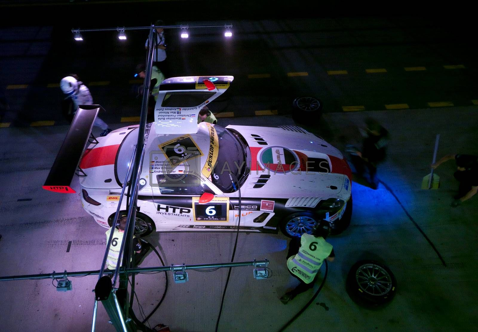 DUBAI - JANUARY 13: Aerial view of car 6, a Mercedes SLS AMG GT3 during pit stop at night at the 2012 Dunlop 24 Hour Race at Dubai Autodrome on January 13, 2012.