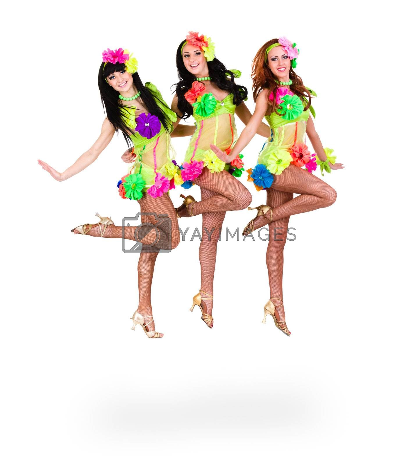 three beautiful carnival dancers women jumping against isolated white background