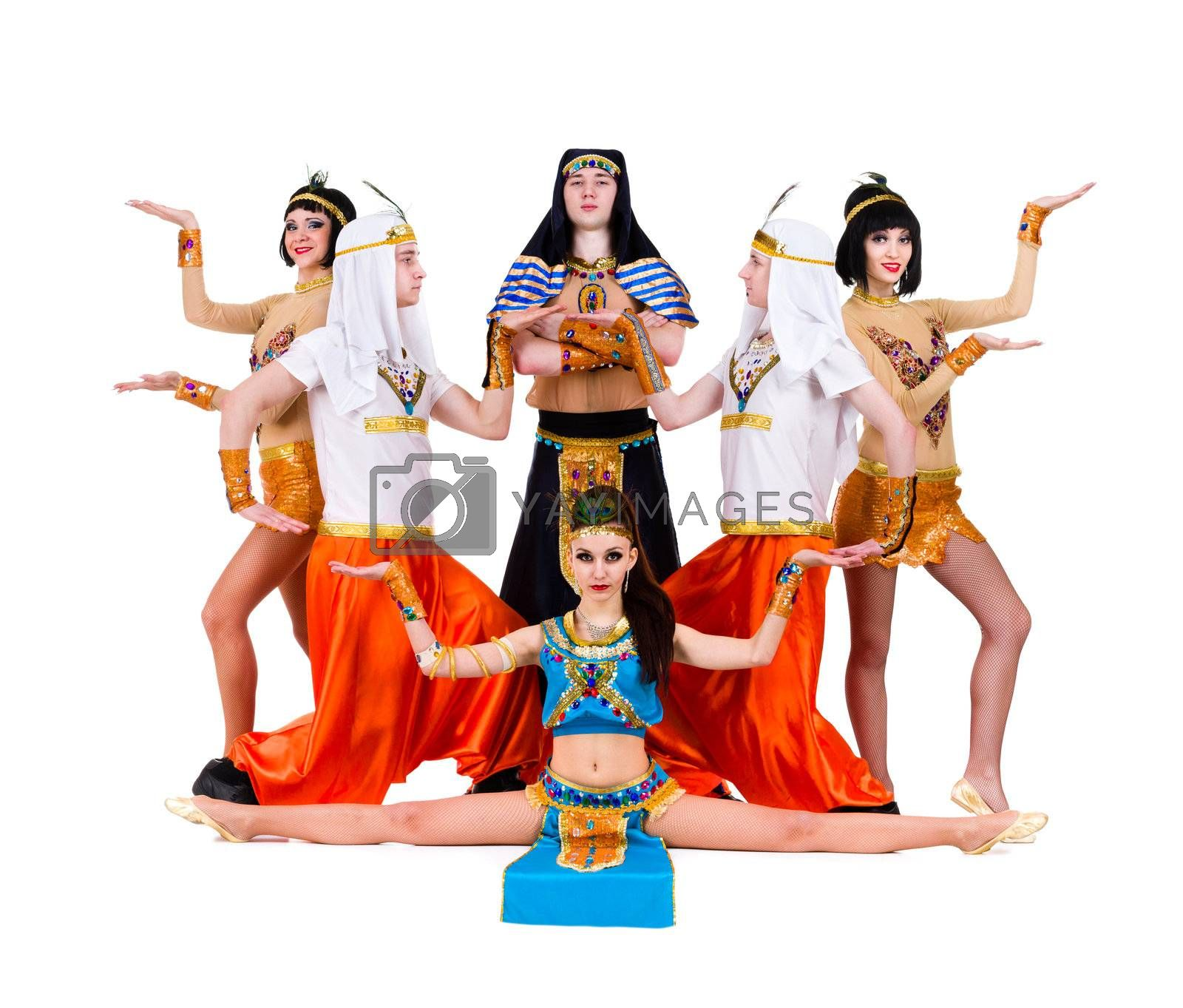 dance team dressed in Egyptian costumes posing.  Isolated on white background in full length.