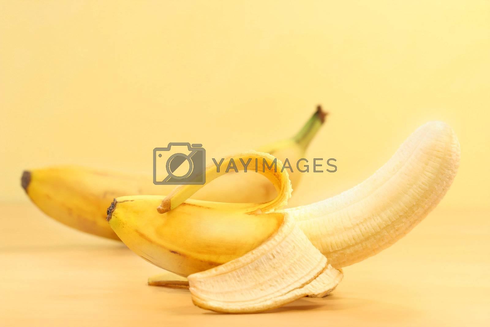 Bananas with banana peel on counter