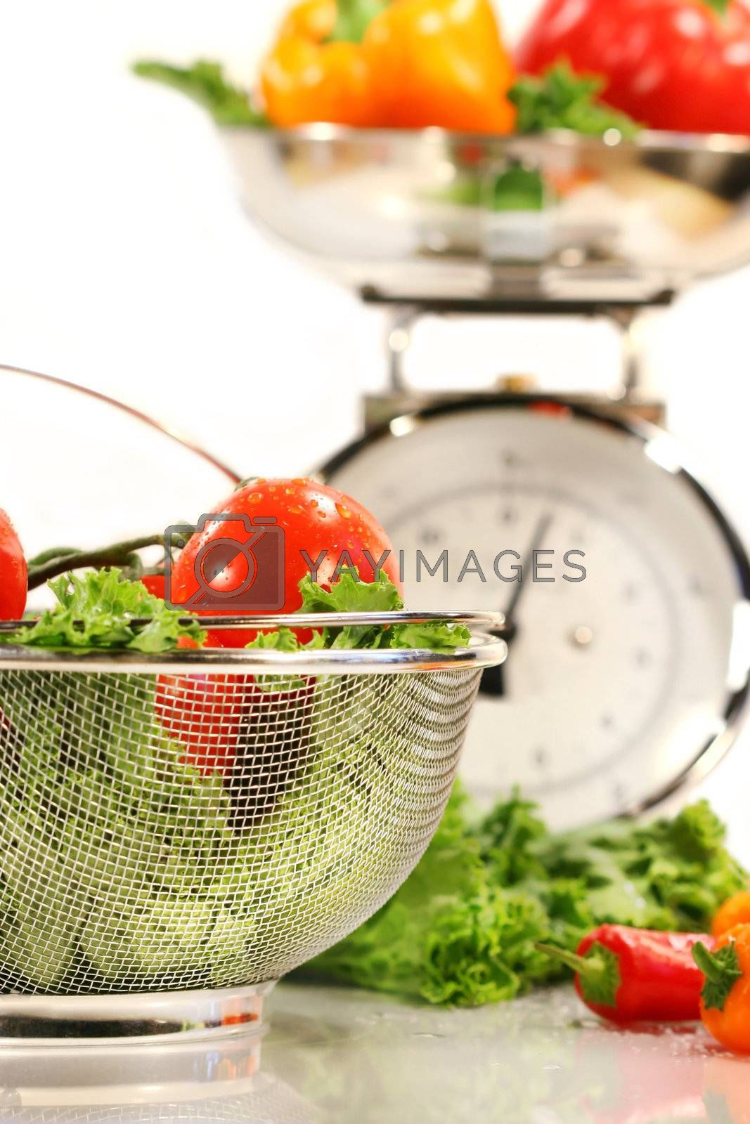 Vegetables, food basket and kitchen scale on white background