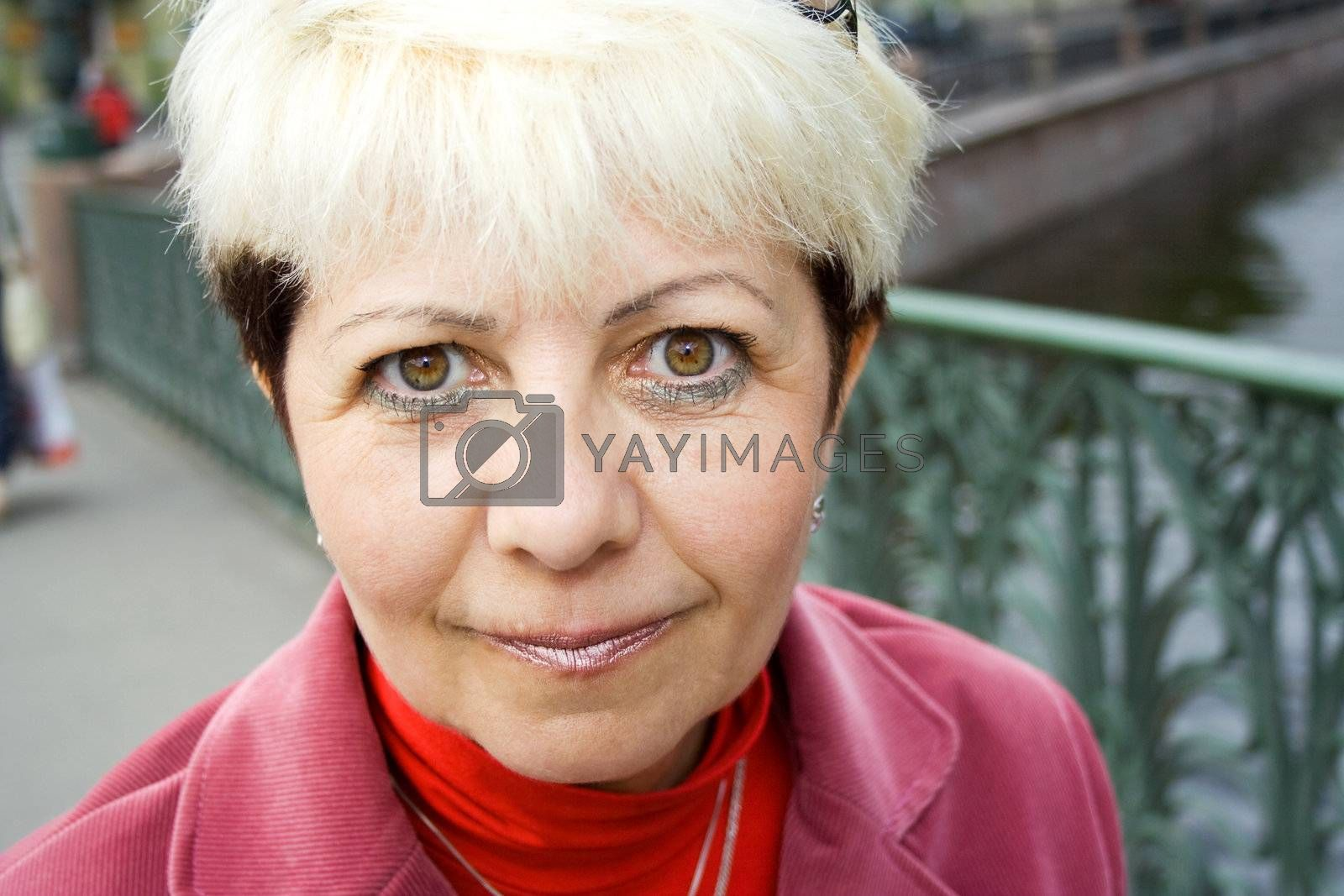 portrait of attentive senior woman looking leery at camera