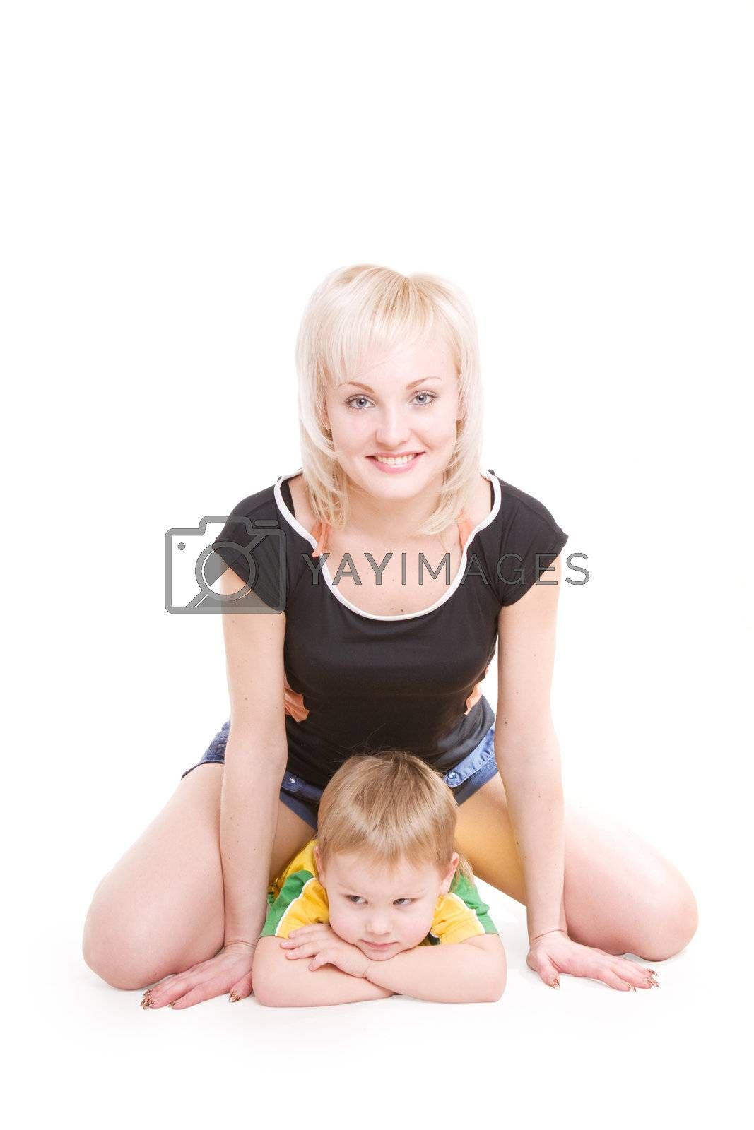 smiling happy young mother and her little son on the floor