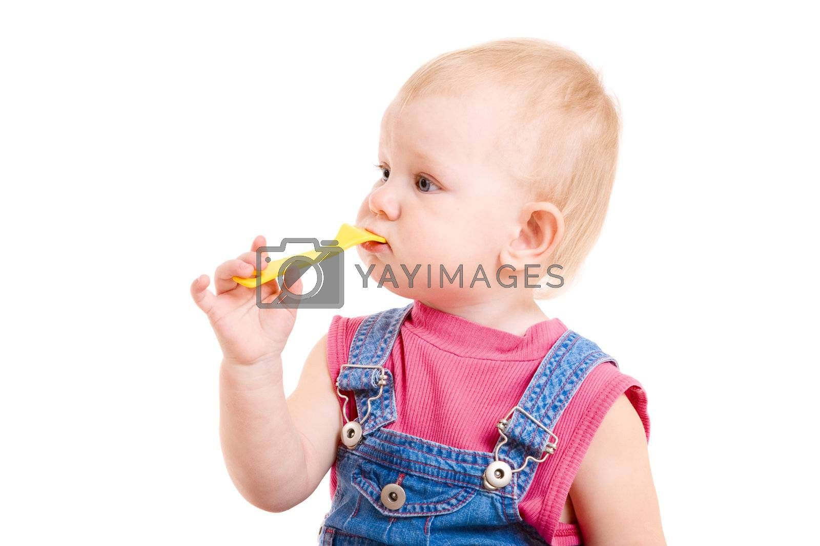 small girl eating with a toy fork
