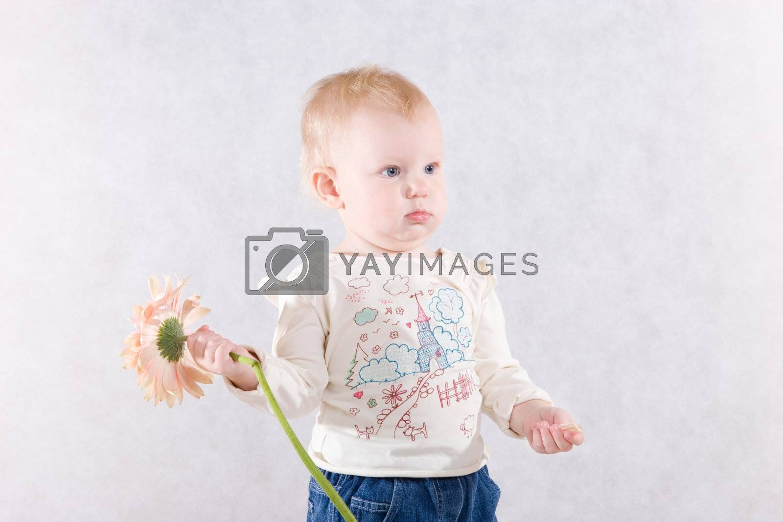 The girl with a pink flower in hands