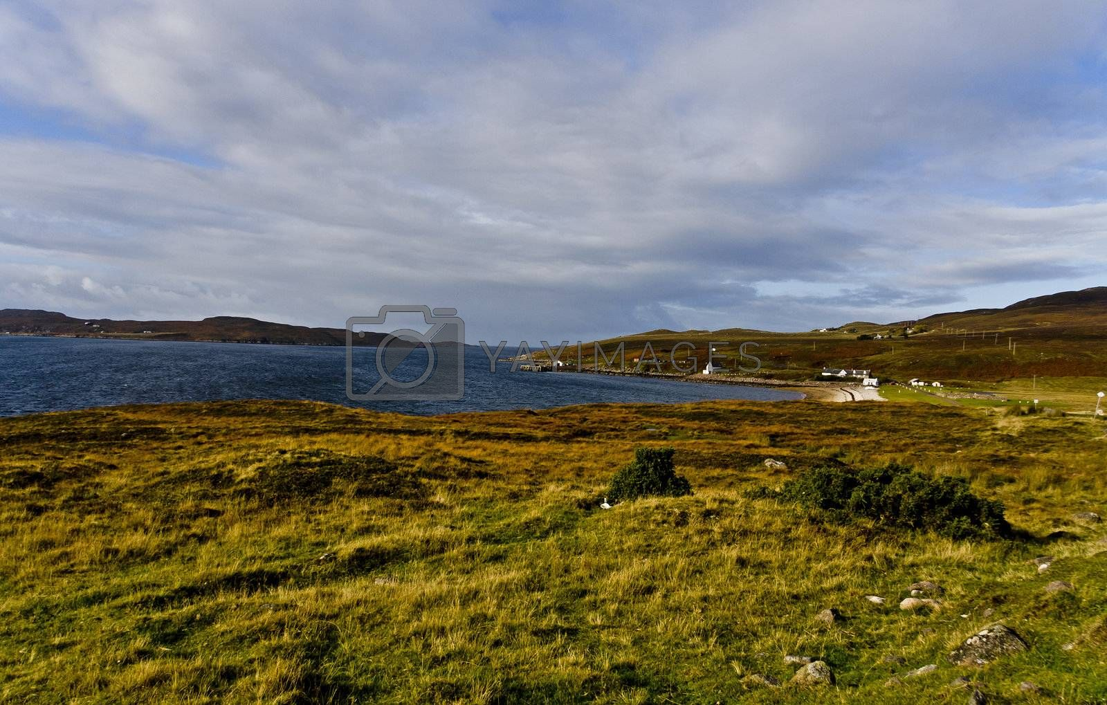 rural scottish scene at the coast with wetland and cloudy sky