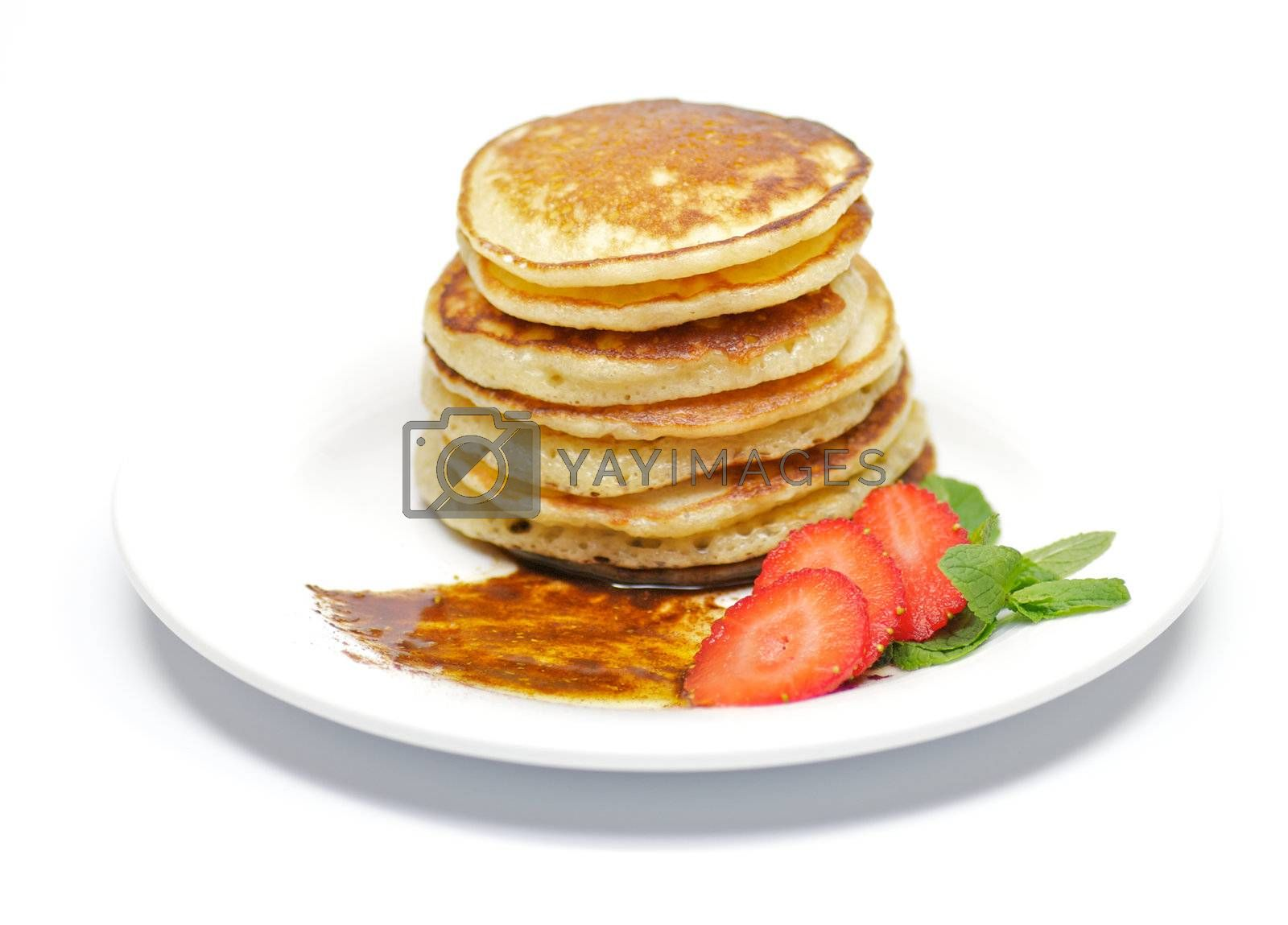 Pancake Fritters with a strawberry, сinnamon, honey and leaflets of mint