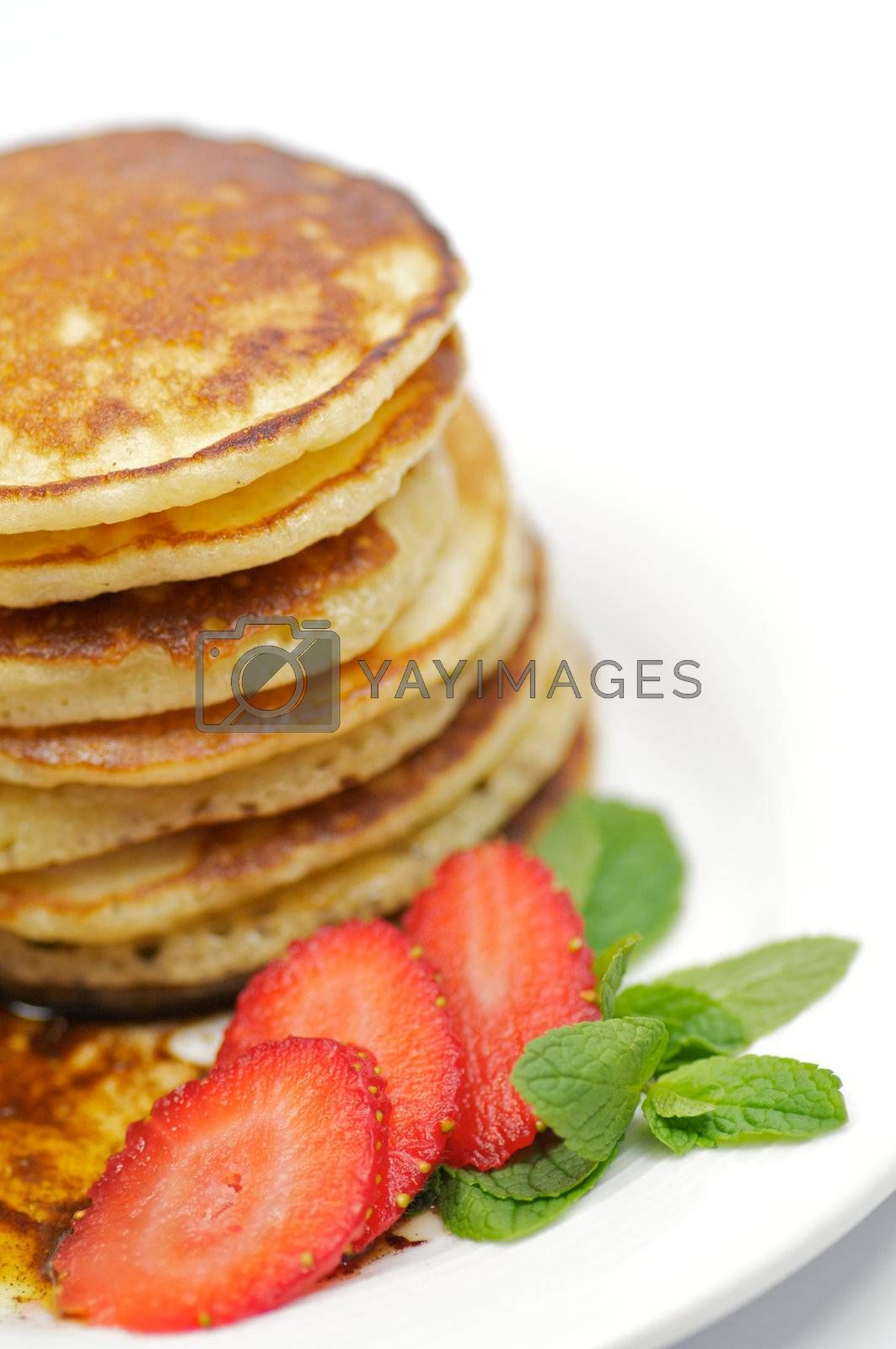 Pancake Fritters with strawberry and leaflets of mint