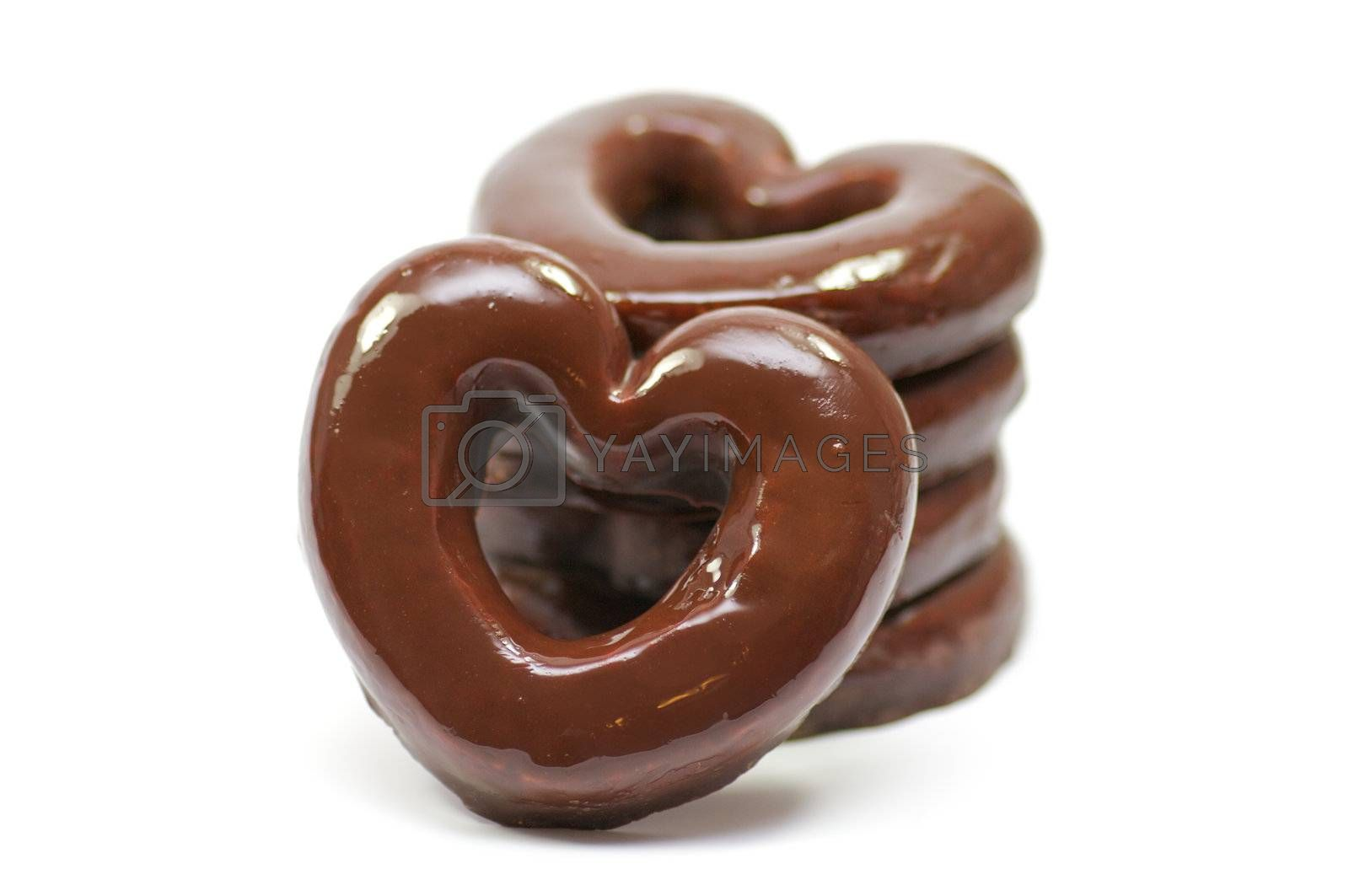 Chocolate hearts-rings in glaze isolated in white background