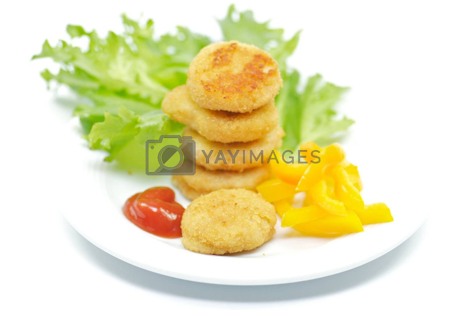 Chicken Nuggets with salad leaves and bell pepper