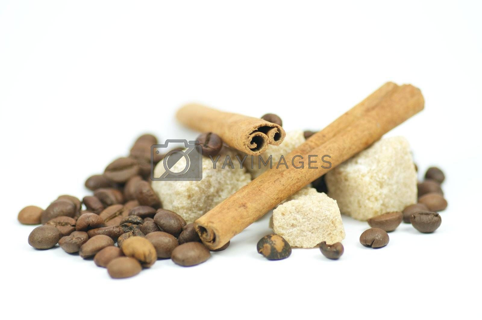 Cinnamon sticks, brown sugar and coffee grains isolated on white background