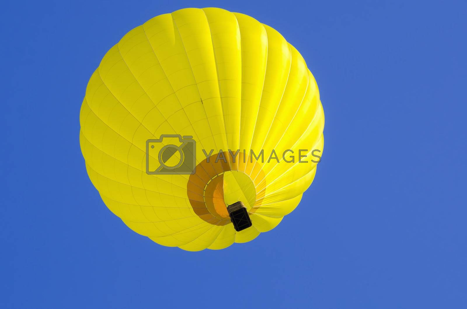 yllow hot air balloon in blue sky