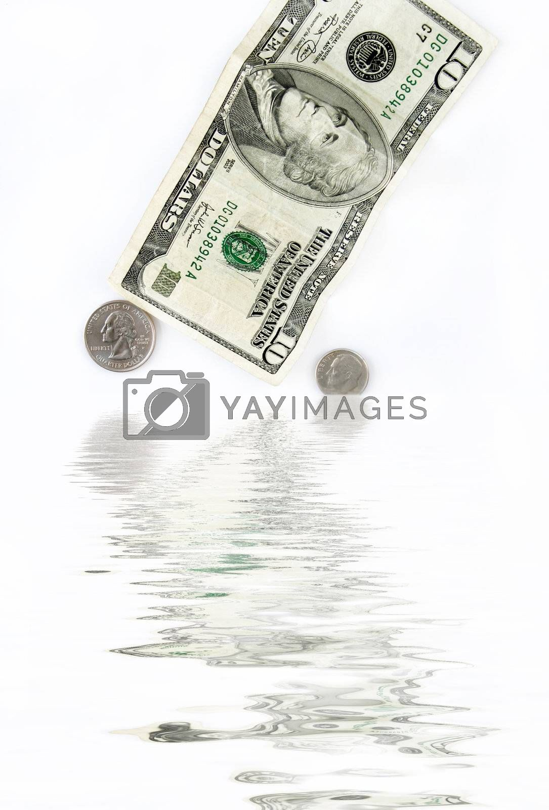 Ten dollar bill and loose change going into water.  Concept of a sinking economy.