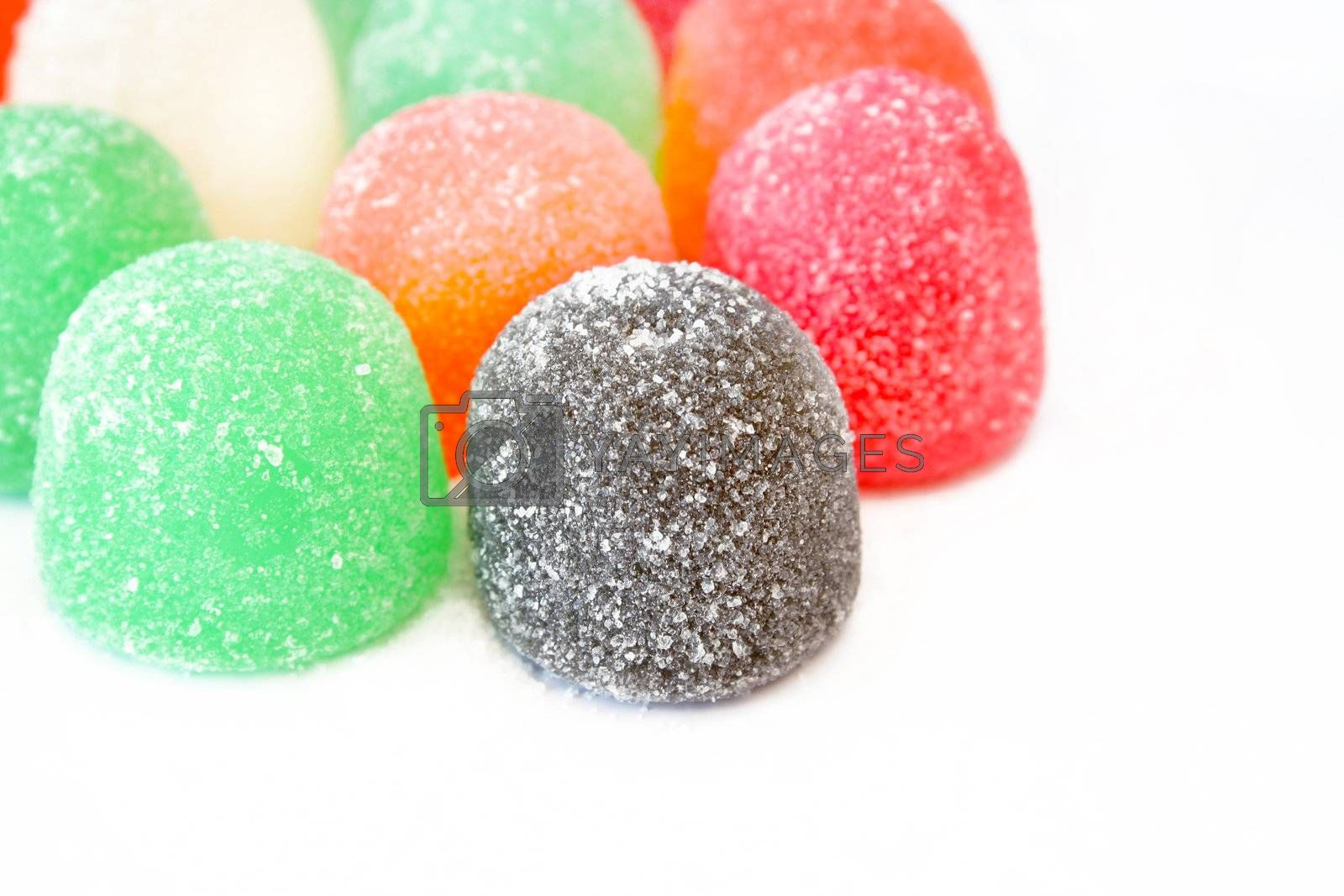 Close up of gumdrops on a white background with copy space.