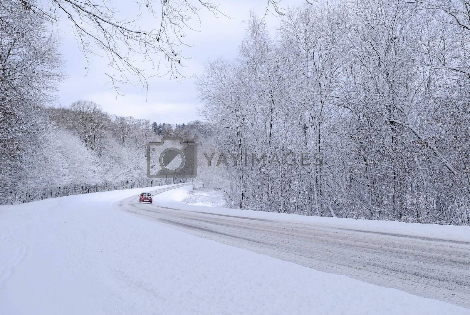 a red car on a snowy road