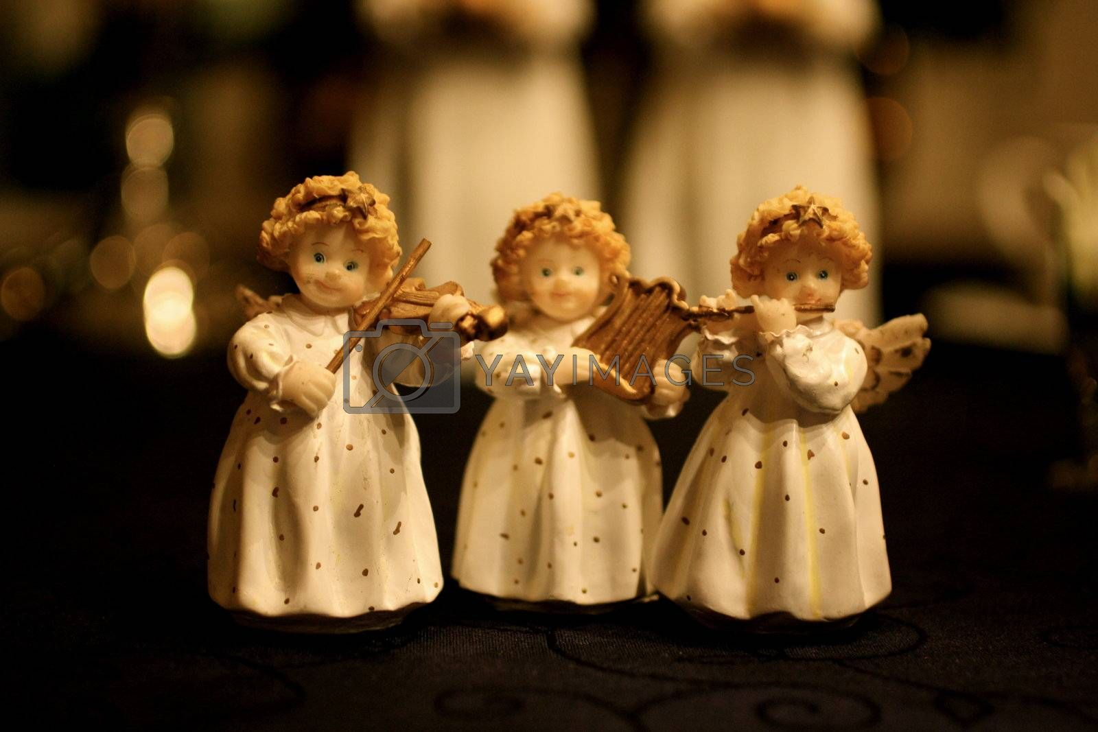 Angels on a table set for Christmas