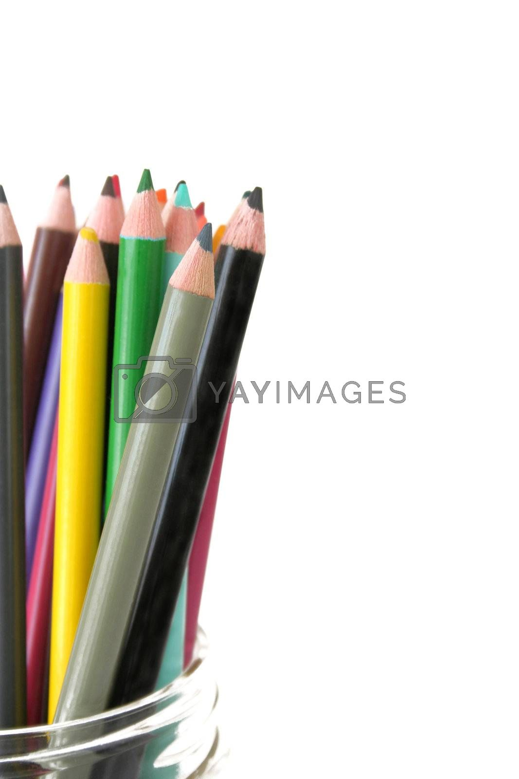 Colorful pencils in a jar against a white background.  Copy space available. Used a shallow depth of field with selective focus.