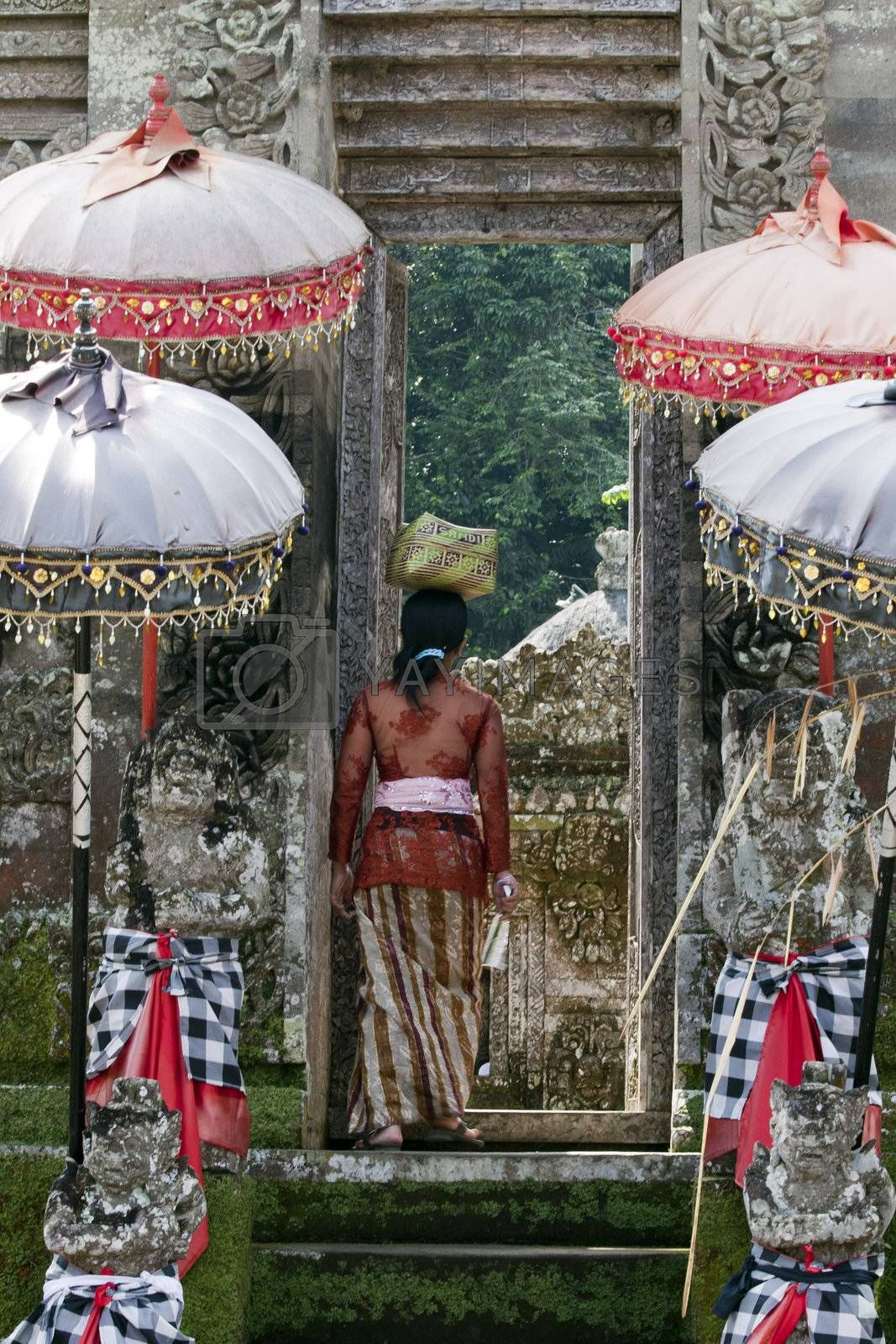 Balinese woman entering a temple